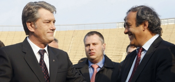 UEFA President Michel Platini (R) talks with Ukrainian President Viktor Yushchenko as they inspect construction work at the stadium which is due to host the final of the Euro-2012 soccer championship.